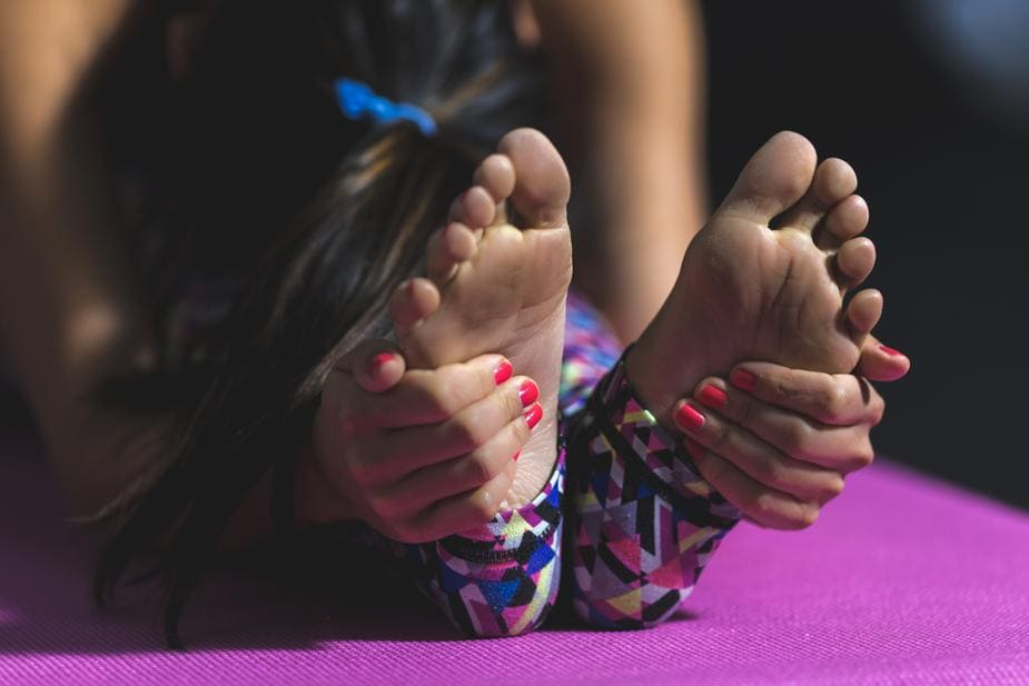 yoga-forward-fold-feet_925x